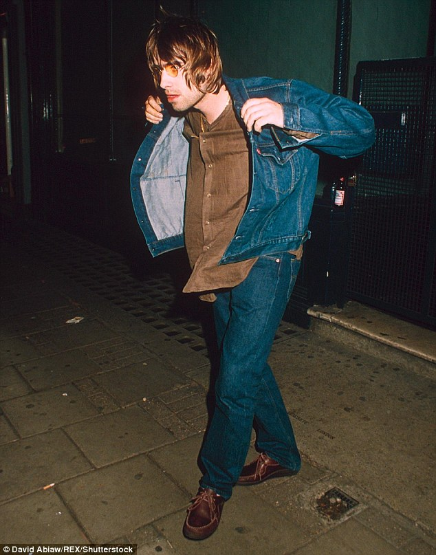 Throwback: Liam puts on his jacket after an Oasis gig in London in 1996