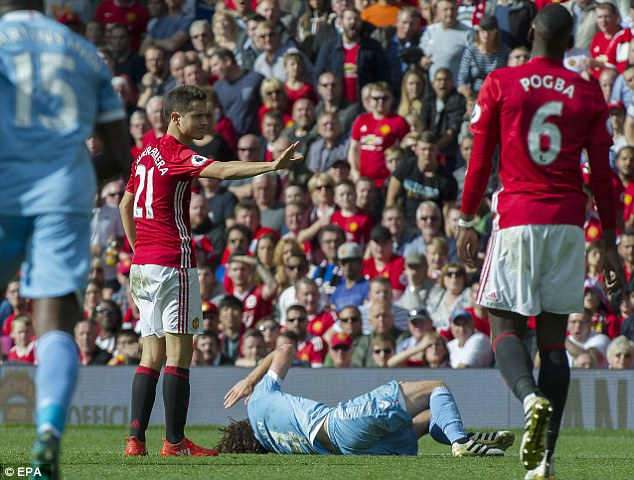 Ander Herrera caught Joe Allen with a dangerous high tackle at Old Trafford on Sunday