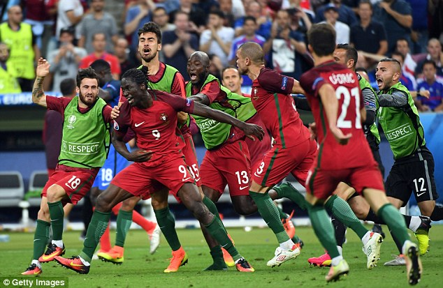 The Portugal substitute is mobbed by team-mates as Portugal pulled off a shock victory over the hosts