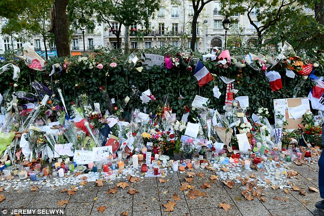 Mr Younger said 'deep social economic and demographic drivers' meant there was little sign of the 'enduring' danger disappearing soon. Pictured, flowers outside the Bataclan theatre in Paris after the terrorist attacks of 2015