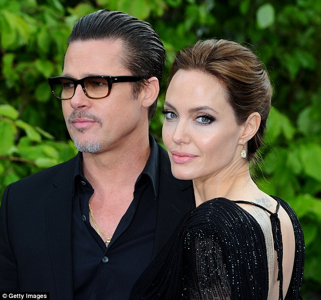 Child protection services began investigating the Fight Club star shortly before Jolie filed for divorce, and notified the LAPD, which then turned to the FBI (pictured the couple in 2014)