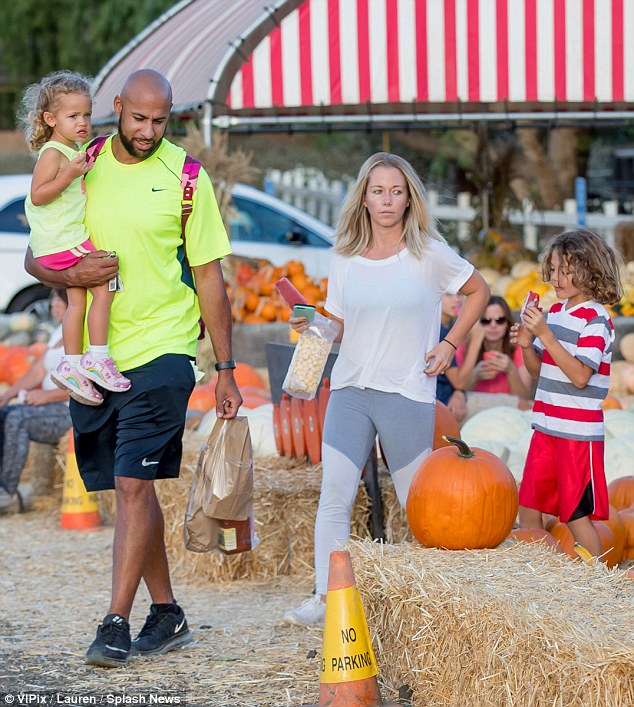 Family time: On Friday, Kendra Wilkinson and Hank Baskett took their six-year-old son Hank and two-year-old daughter Alijah to Underwood Family Farms in Moorpark, California