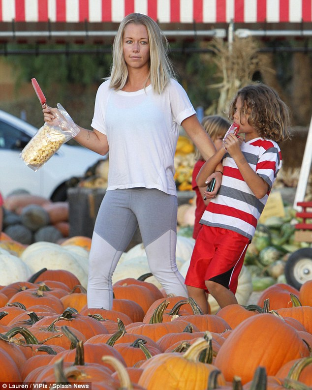 Frozen treats: Mother and son both enjoyed red popsicles as they strolled through the pumpkin patch