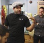 In this Thursday, Oct. 6, 2016 photo, Willy Castillo makes a point while his brother, Steven Castillo, looks on at the Los Compadres Barber Shop in Allentown, Pa. A city councilman is stirring controversy with his proposal to install decorative Spanish-language street signs on Seventh Street, where the barber shop is located. (AP Photo/Michael Rubinkam)