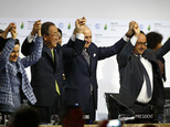 FILE - In this Dec. 12, 2015, file photo, French President Francois Hollande, right, French Foreign Minister and president of the COP21 Laurent Fabius, second right, United Nations climate chief Christiana Figueres, left, and United Nations Secretary General Ban Ki-moon hold their hands up in celebration after the final conference at the COP21, the United Nations conference on climate change, in Le Bourget, north of Paris. A team of top scientists are telling world leaders to stop congratulating themselves for a Paris agreement to fight climate change because if more isn¿t done the world will likely hit the agreed-upon dangerous warming level in about 35 years.  (AP Photo/Francois Mori, File)