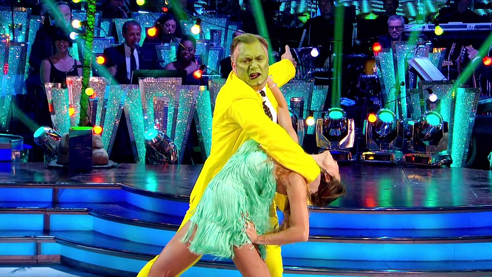 Strutting his stuff: Ed with his yellow suit and green face in his 'Mask' style dance with Kataya on Saturday night