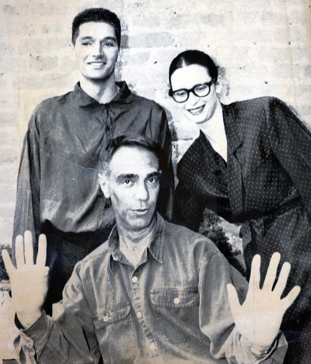 Film-maker Derek Jarman's lover, Keith Collins, is suing art dealer Richard Salmon over 70 missing works of art. Jarman is pictured centre with Collins and actress Tilda Swinton in 1991