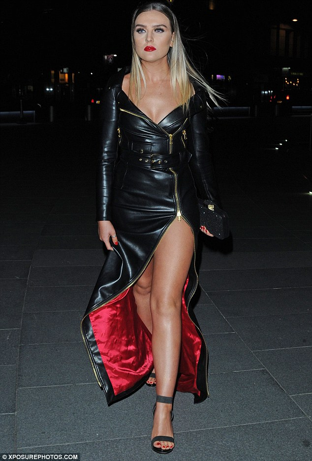 Leather lady! Perrie Edwards, 23, made a seriously glamorous arrival in a sleek leather maxi dress at Leigh-Ann Pinnock's birthday party on Saturday night