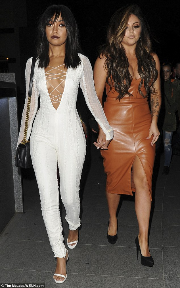 Centre of attention: Birthday girl Leigh-Ann Pinnock (left) ensured all eyes were on her in a white lace figure-hugging bodysuit which flaunted her enviably gym-honed figure