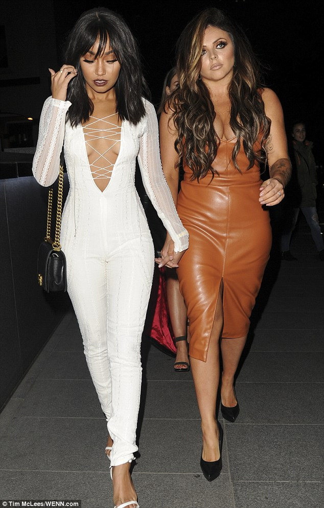 Tan-tastic: The pair were joined by Jesy Nelson (middle) who showed off her sensational curves in a sexy tan leather midi and black platform heels
