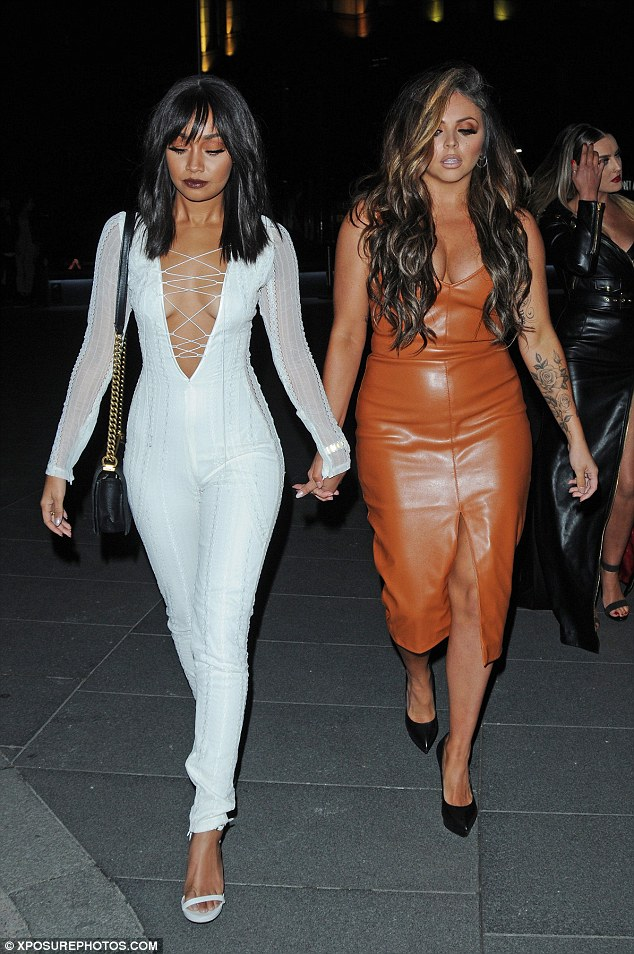 Outfit number 1: She went braless in a sexy white catsuit with lace-up detailing running down the front