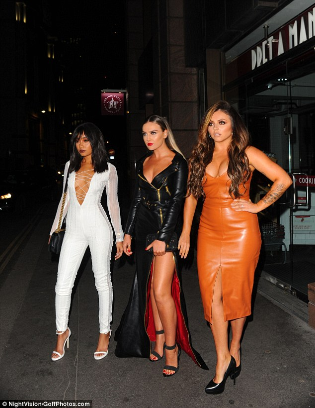 Standing out: The girls put on a glamorous display as they posed for pictures