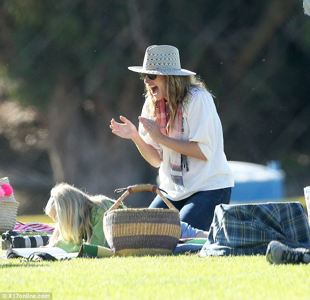 Pretty happy: Julia Roberts, 48, cheered on her children at a soccer match Saturday in Malibu
