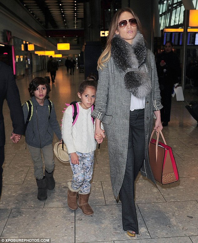 Family first: The busy star still makes plenty of time for the most important people in her life - her eight-year-old twins, Max and Emme; pictured April 8