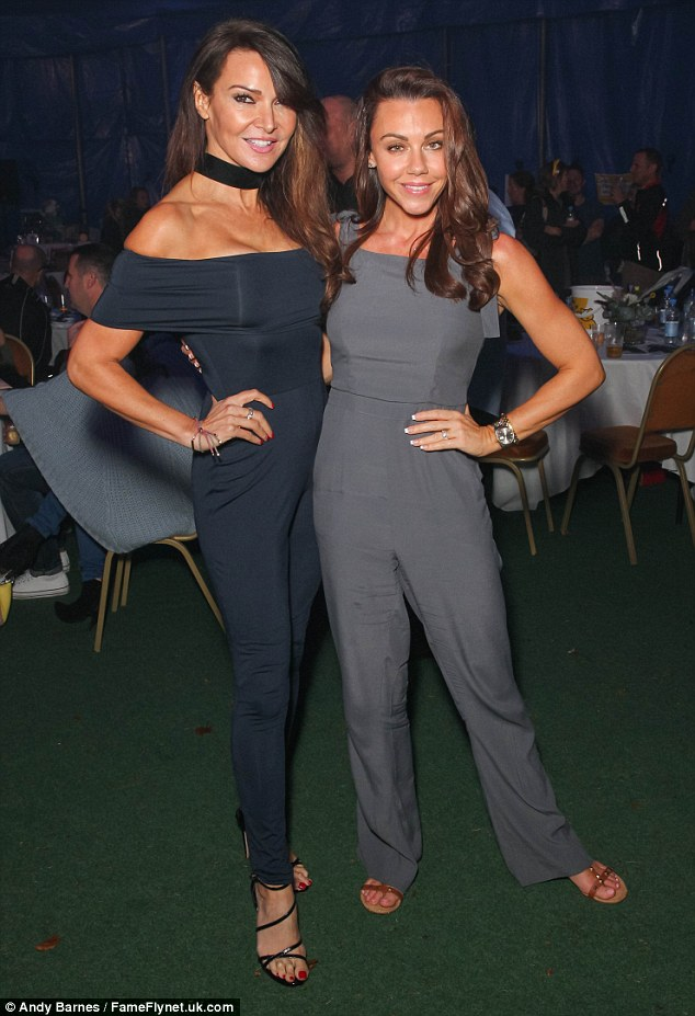 Matchy matchy:The brunette seemingly co-ordinated with friend Michelle Heaton at the bash - who attended the fundraiser in a similar grey all-in-one