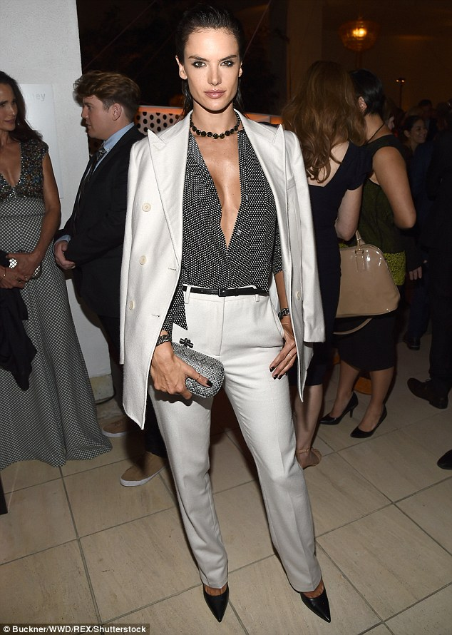 Eye-popping! The Brazilian beauty made sure to show plenty of sideboob in her classic white suit which she paired with a black polka dot dress shirt