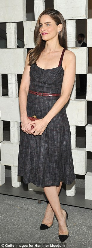 Slender star: Actress Amanda Peet, 44, showed off her slim waistline in a black denim dress with thin red leather belt