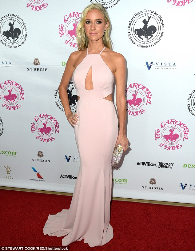 Fancy night out: Kristin Cavallari wowed in a blush halter gown for the 2016 Carousel Of Hope Ball on Saturday