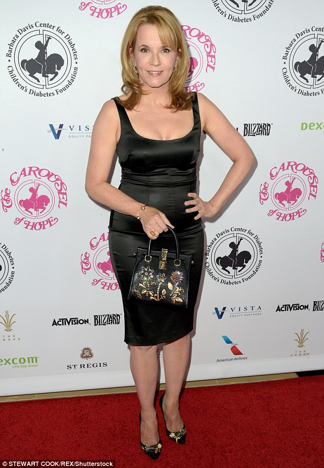 Classic: Lea Thompson arrived in a classic little black dress while toting an embroidered bag
