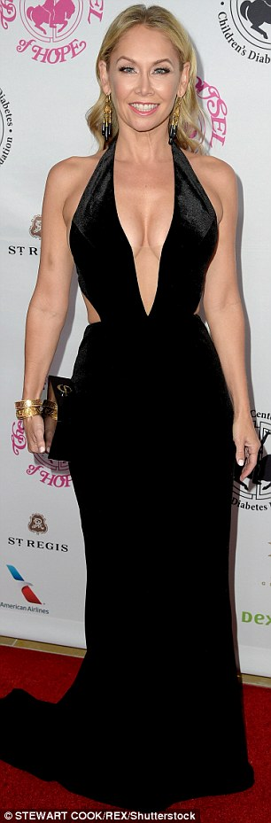 Stunner: Kym Johnson showed off her incredibly toned dance body in a plunging black dress