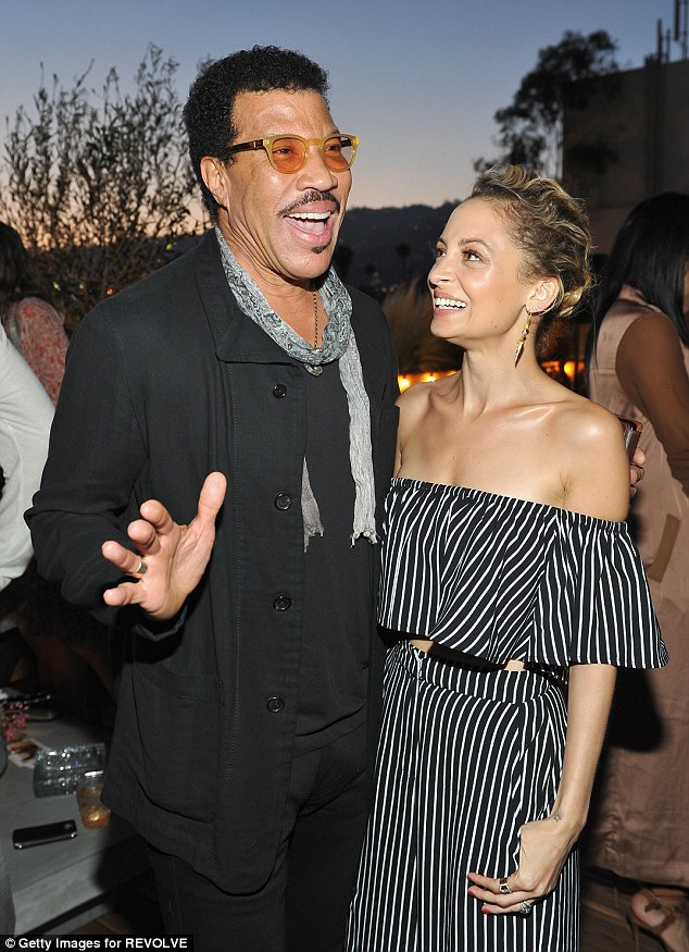Daddy's girl: Nicole looks with awe at her father Lionel Richie at a June event she threw for her fashion line, House of Harlow 1960