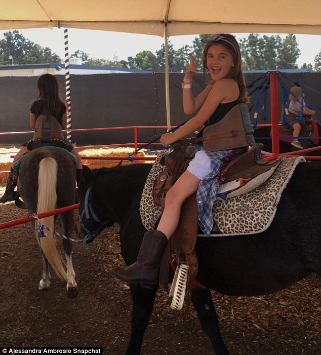 Horsing around! Alessandra shared several Snapchat photos and videos of her two kids who she shares with her businessman fiancé Jamie Mazur