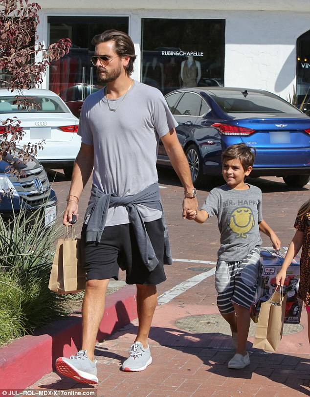 Family matters: Scott Disick held hands with his son Mason, six, as they spent some quality time together in Malibu on Saturday
