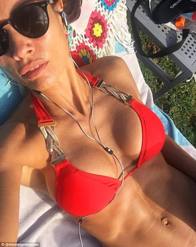 Stunner: Mel Sykes was showing off again on Saturday when she shared an Instagram post of herself sunbathing in the garden