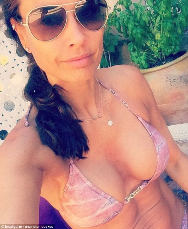 Bikini babe: The mother-of-two showed off her sensational figure while holidaying in Mallorca, on Saturday