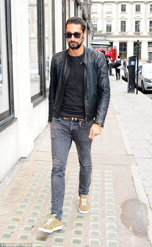Casual: Hugo was dressed down in a rock 'n' roll inspired look, rocking a biker jacket over a fitted top and jeans
