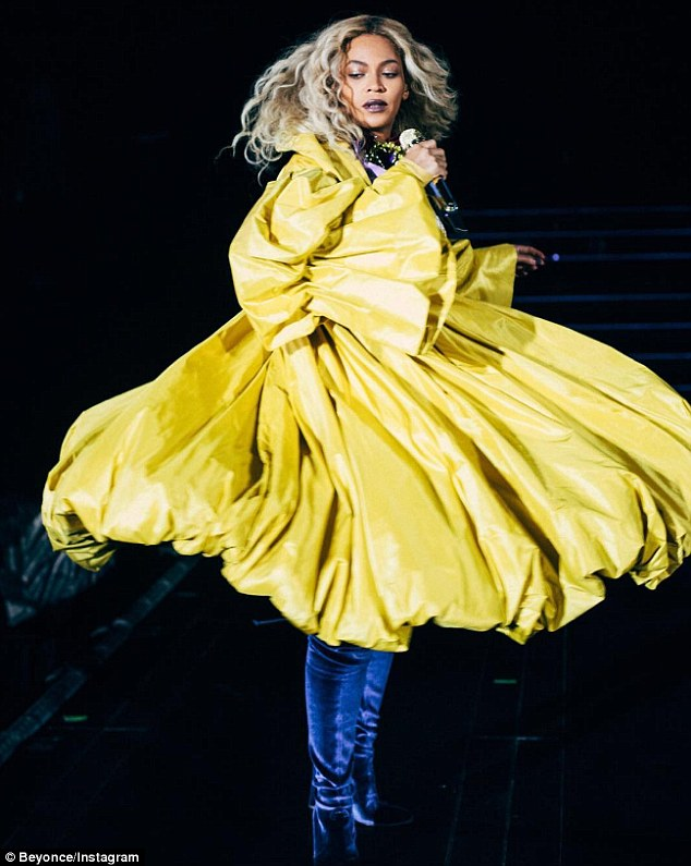 Twirl: The mother-of-one spun around stage in a billowy yellow number