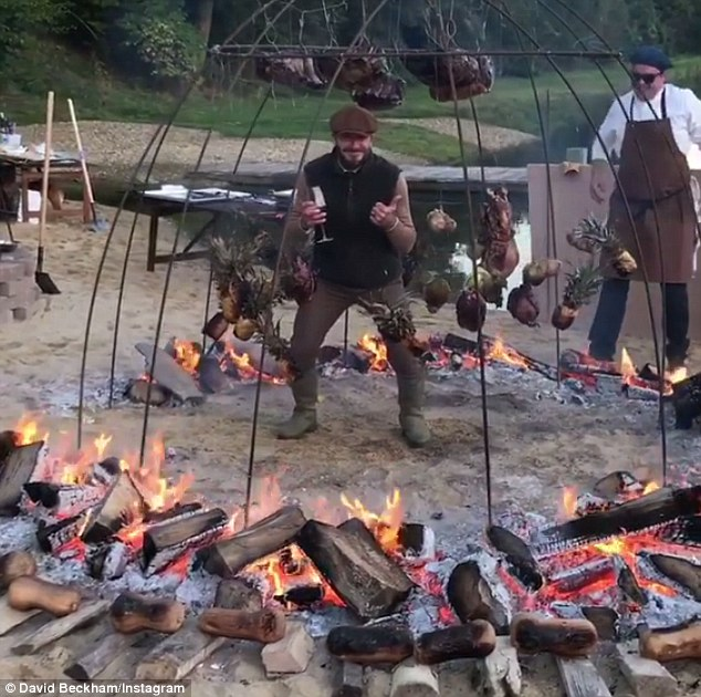 Having a laugh: David has been enjoying some down-time recently and had an epic boys' night with good pal, Guy Ritchie where they built a giant caged wood fire