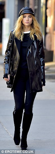 Back in black: Her second outfit was an all-black affair with a peaked leather hat, a PVC coat and skintight leggings