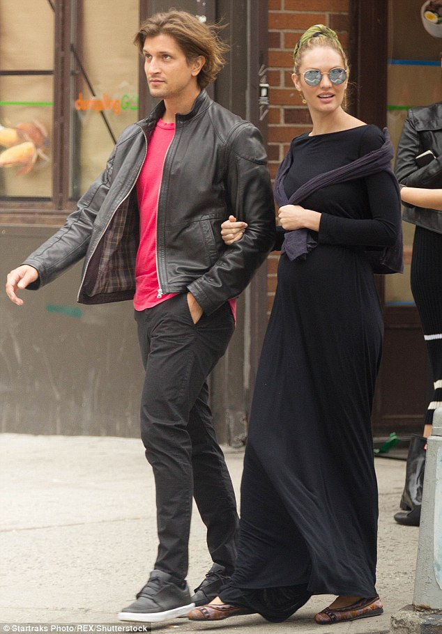 Arm in arm: The fellow models, pictured in New York City this May, have been engaged since last August