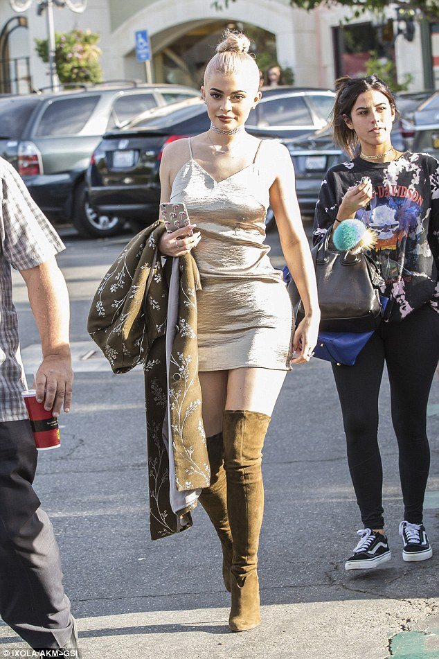 Golden girl! Heads were turning when Kylie Jenner stepped out in her second outfit of her day for dinner at Sugarfish in Calabasas on Friday
