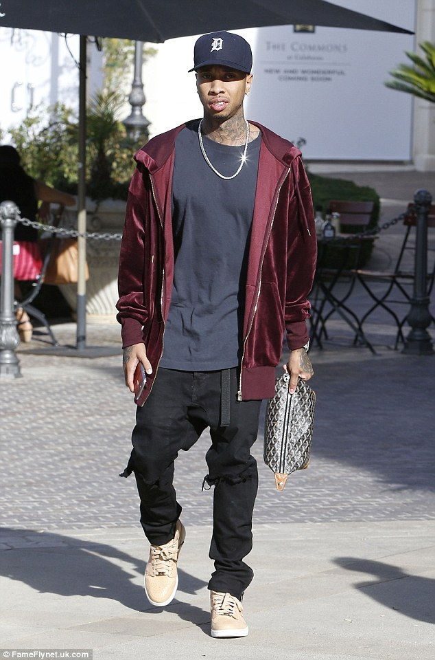 Look who's here! Jenner's beau Tyga was also seen out in Calabasas at the Rolex store that day