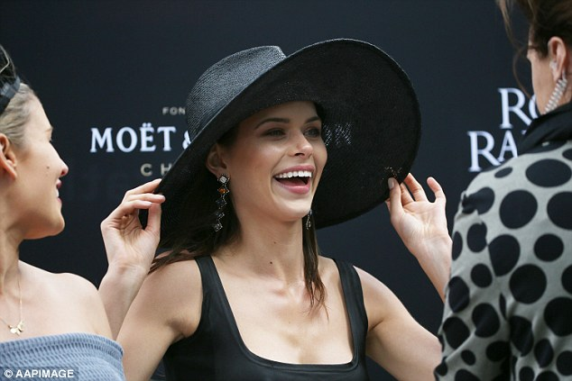 Having a ball: Georgiawas spotted laughing while speaking to several other VIP guests