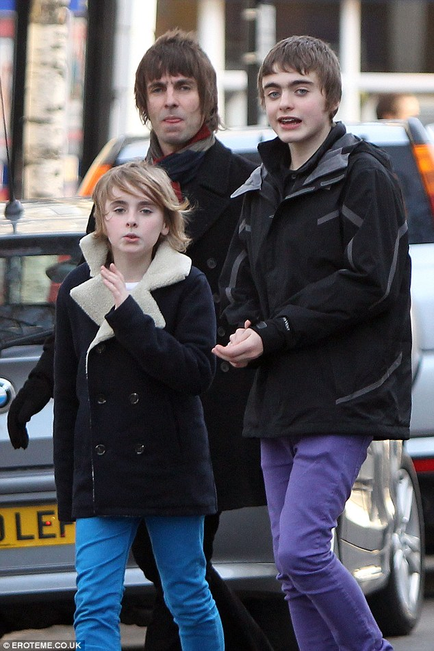 On the move: Liam with son Gene Gallagher and Noel's daughter Anais in 2000