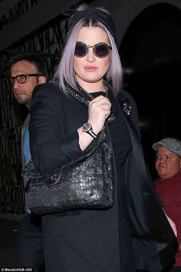 Rock chic: Kelly Osbourne channeled her rockstar genes when she headed to dinner in Los Angeles in an all-black ensemble on Friday night