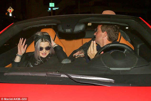 Flash ride: The star - who had a UK number One singing Changes with Ozzy in 2003 - was all smiles as she got into a friend's red Ferrari for the trip to Craig's restaurant