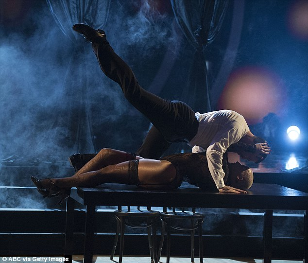 Flat out:Audience members were seen fanning themselves during the Tango to Cirque Du Soleil's already sexy Zumanity, a dance that ended with Maks climbing on top of Amber on a table
