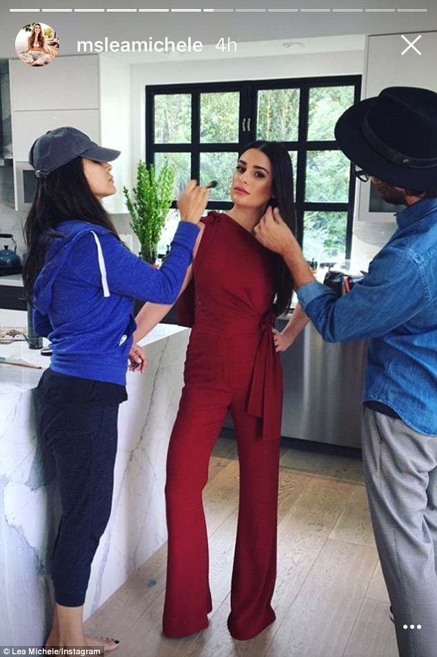Team effort:Thanks to some very diligent make-up artists, the multi-talented actress sported rouge, eye-liner and a slick of ruby lipstick which complemented her outfit nicely