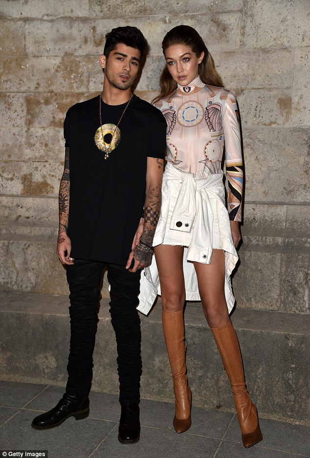 Leggy display: Tall model Gigi almost towered over her stunning beau