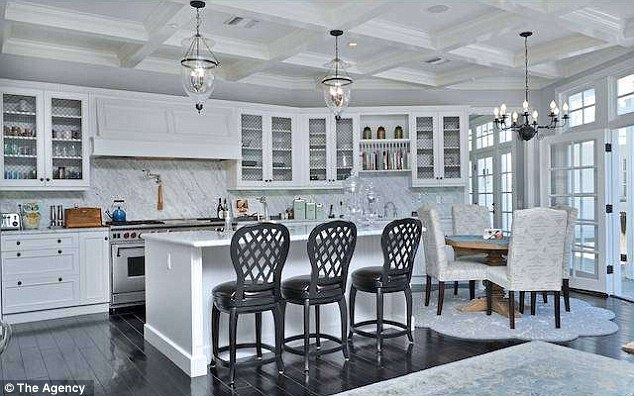 Welcome home: The basketball player's spacious kitchen features hard wood floors