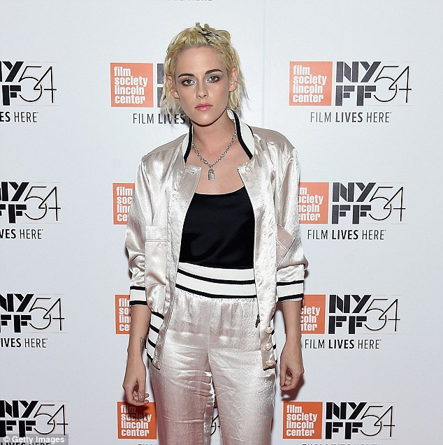 The mane attraction!Kristen's bright blonde hair was styled into messy waves as it was slicked back from her face