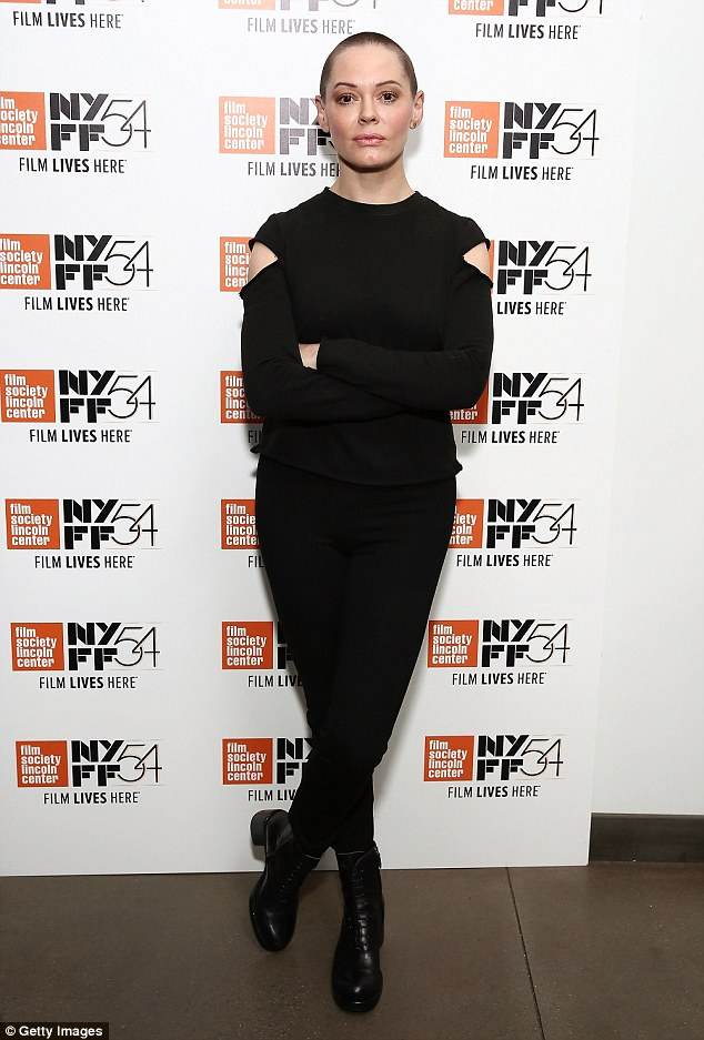 Super edgy! Rose McGowan wore a slashed black blouse, trousers, and boots at I Am Indie in New York on Friday
