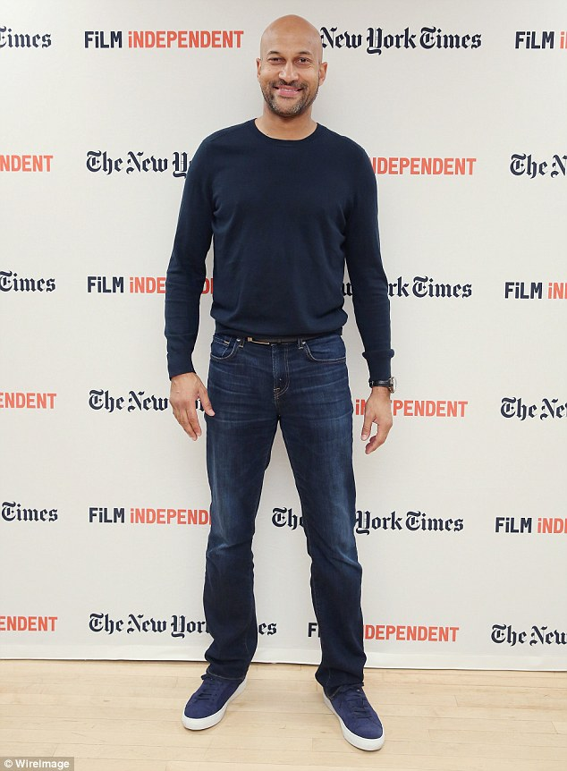 The blues: Funnyman Keegan Michael-Key, 45, attended as well in a laid-back ensemble consisting of a navy long-sleeve shirt, jeans and blue sneakers.