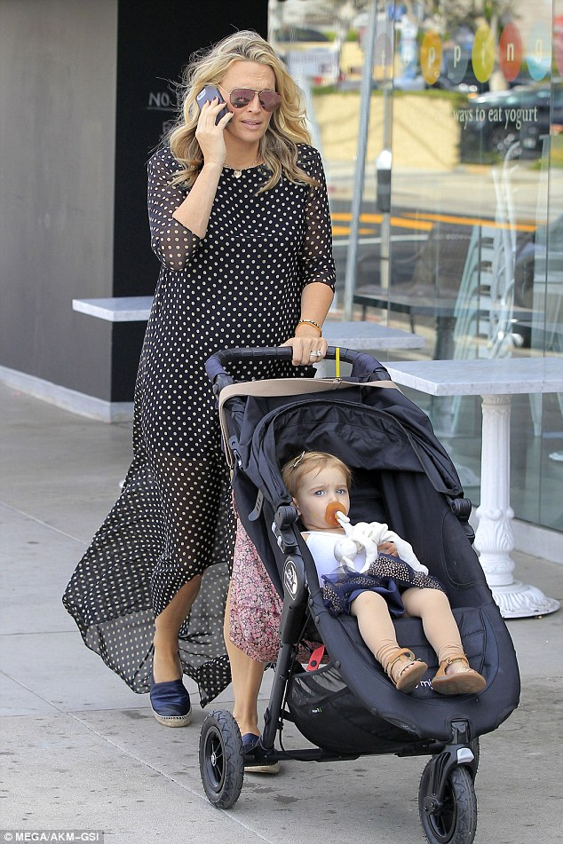 Stylish: Molly was both chic and comfortable in a sheer, polka dot dress that featured a high-slit bottom