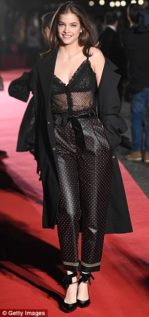 Work it:Adding a thick black belt to her petite middle, the trousers cinched in her enviably slender figure and emphasised her tiny waist as she posed up a storm