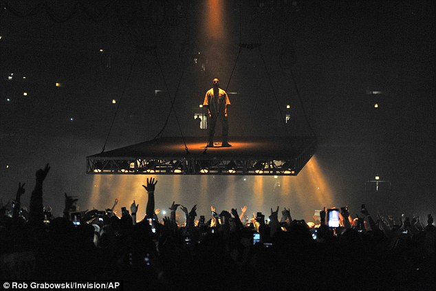 Up and away: The rapper was lifted above the audience